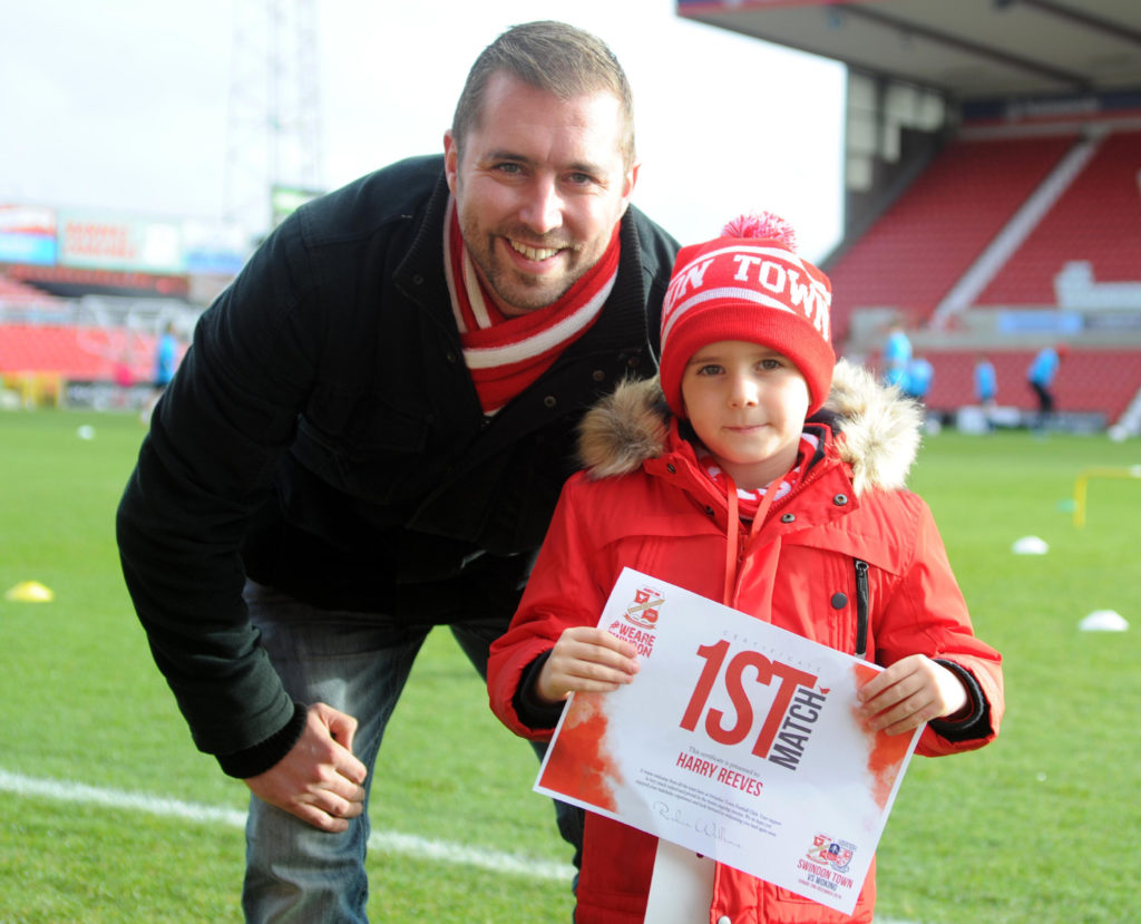 A Swindon Town fans and his dad whit the First Match diploma